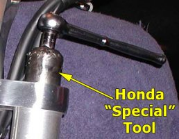 Removing rebound rod assembly w/ Honda