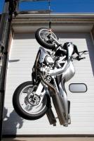 Spiegler brake line holding up a motorcycle