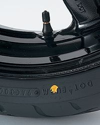 Yellow dot on tire aligned with valve stem