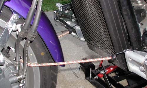 Bungee cord wheel holder