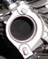 Rear exhaust port with new gasket in place
