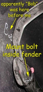 Left mount bolt inside fender