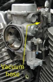 Carburetor w/ vacuum hose